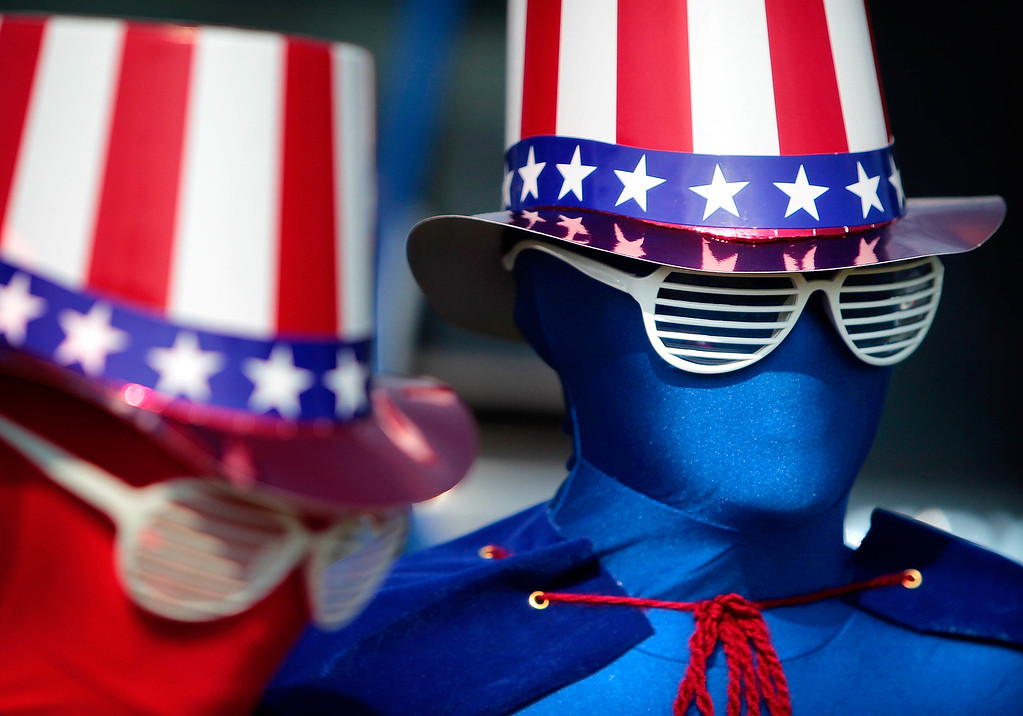 . Decked out from head to toe in patriotism,  Remi Schaber (left), 9, and her brother Chase, 11, don spandex suits for the Cordova Independence Day Parade Thursday morning at the Cordova Community Center in Cordova, Tenn. Thursday, July 4, 2013.  (AP Photo/The Commercial Appeal, Jim Weber)