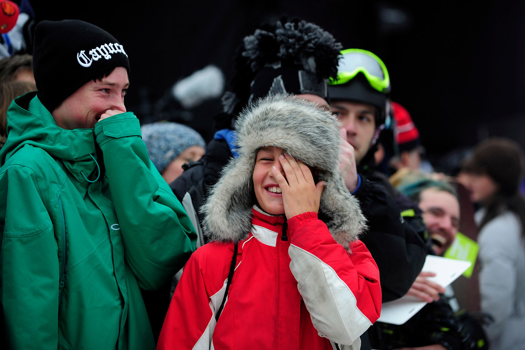 . ASPEN, CO. - JANUARY 24:   Kids laugh as ESPN commentators goad the crowd into getting excited to be on live TV at the 2013 Aspen X Games on Buttermilk Mountain. (Photo By Mahala Gaylord / The Denver Post)