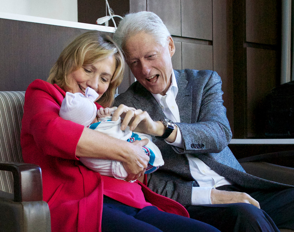 . This photo provided by Clinton spokesman Kamyl Bazbaz shows former Secretary of State Hillary Rodham Clinton, left, and former President Bill Clinton, right with their granddaughter Charlotte Clinton Mezvinsky on Saturday, Sept. 27, 2014, at Lenox Hill Hospital in New York. The Clintons\'s daughter, Chelsea, gave birth Friday night to her first child, Charlotte. (AP Photo/Office of President Clinton, Jon Davidson)