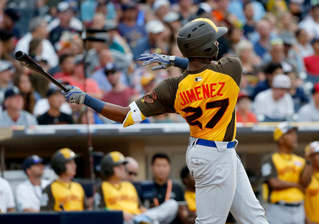 . World Team\'s Eloy Jimenez, of the Chicago Cubs, hits a three run home run against the U.S. Team during the ninth inning of the All-Star Futures baseball game, Sunday, July 10, 2016, in San Diego. (AP Photo/Lenny Ignelzi)