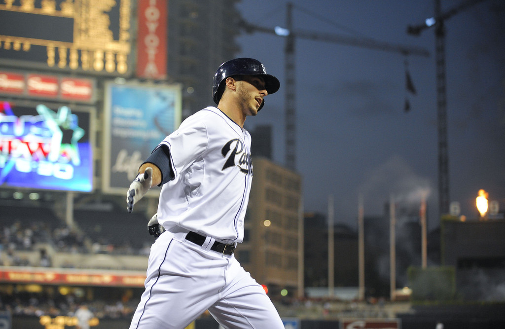 . SAN DIEGO, CA - APRIL 16:  Tommy Medica #14 of the San Diego Padres scores after hitting a solo home run during the second inning of a  baseball game against the Colorado Rockies at Petco Park April 16, 2014 in San Diego, California.  (Photo by Denis Poroy/Getty Images)