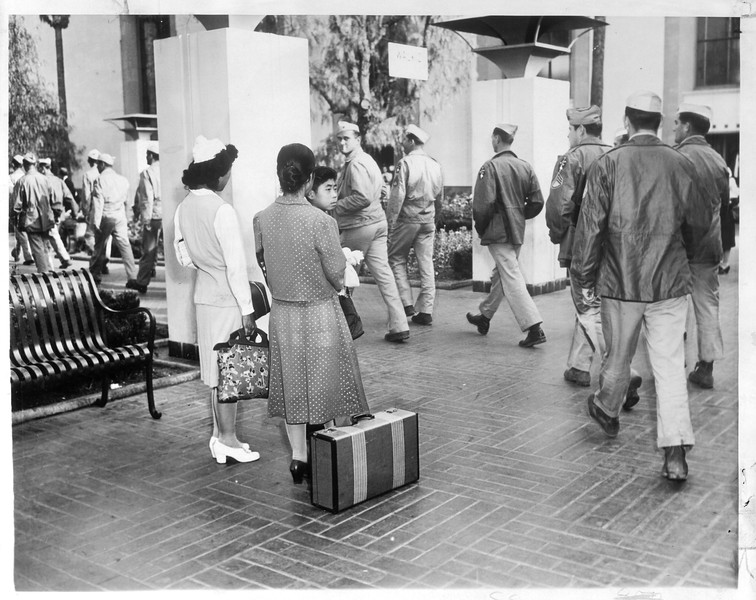 """""""Dramatic Meeting -- As the returned Japs chatted gayly at Union Station, a group of Marines (who had seen action tin the Pacific theater) filed past"""" -- caption on photograph"""