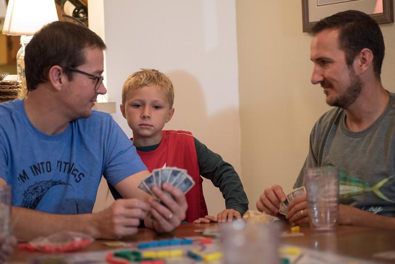 Snelson.holding cards.jpg