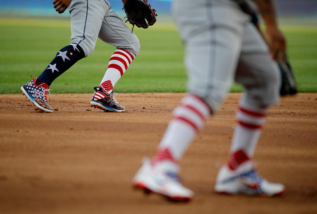 . Wearing patriotic attire, Cleveland Indians shortstop Francisco Lindor, left, and third baseman Jose Ramirez wait for a play during the first inning of the team\'s baseball game against the Kansas City Royals on Tuesday, July 3, 2018, in Kansas City, Mo. (AP Photo/Charlie Riedel)