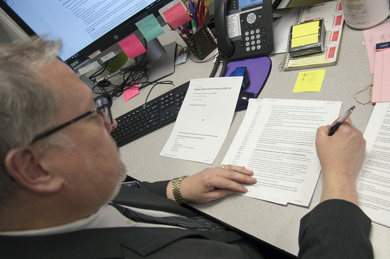 03/19/20   Wesley Bunnell | Staff  Robert Bruzy of New Britain Memorial - Sagarino Funeral Home looks over the most recent paperwork guidelines from the CDC which was received later in the day on Thursday March 19, 2020.