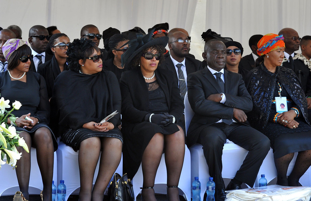. This handout photo taken and released by the Government Communication and Information System (GCIS) shows members of Mandela\'s family attending the burial of South African former President Nelson Mandela on December 13, 2013 in Qunu. Mandela, the revered icon of the anti-apartheid struggle in South Africa and one of the towering political figures of the 20th century, died in Johannesburg on December 5 at age 95.     AFP PHOTO / EDMOND JIYANEEDMOND JIYANE/AFP/Getty Images