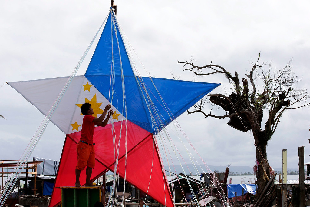 . A Filipino typhoon victims prepares a giant Christmas lantern in the typhoon devastated city of Tacloban, Leyte Province, Philippines, 24 December 2013. Town officials have launched a contest for the best Christmas decoration among the villages in the city of Tacloban, with a first prize of some 1694 euros. The destruction and losses in lives and properties caused by Haiyan are casting a pall over the holiday season, in a country known for having the world\'s longest celebration of Christmas. According to the Philippine disaster relief agency, 6,102 people were killed and 1,779 were still missing from Haiyan\'s onslaught. The typhoon, the world\'s strongest on record, destroyed more than 1 million homes, key infrastructure and commercial establishments.  EPA/DENNIS M. SABANGAN