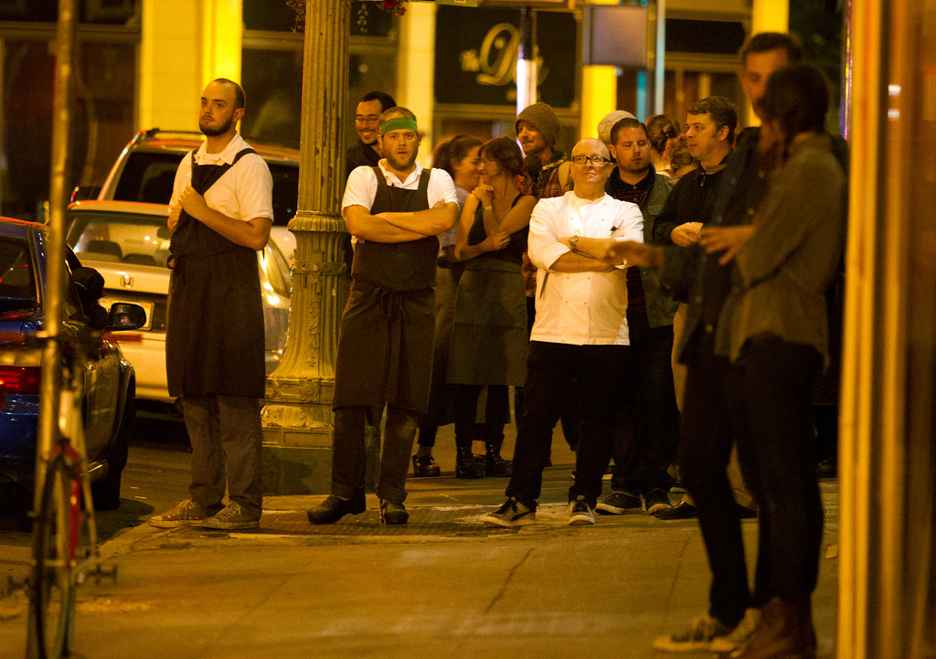 . Patrons and workers of a restaurant on 17th Street stand outside their venue after a disturbance by marchers during a protest of the verdict in the Trayvon Martin murder trial last Saturday in Sanford, Fla., Monday, July 15, 2013 in Oakland, Calif. (D. Ross Cameron/Bay Area News Group)