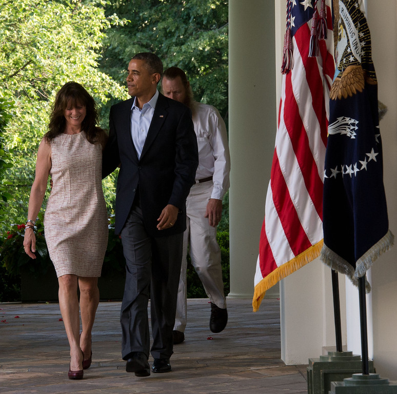 . President Barack Obama walks with the parents of Sgt. Bowe Bergdahl, Jani Bergdahl (L) and Bob Bergdahl (Rear) from the Oval Office to make a statement regarding the release of Sgt. Bergdahl from captivity May 31, 2014 in the Rose Garden at the White House in Washington, DC. Sgt. Bowe Bergdahl was held captive by militants for almost five years during the war in Afghanistan. (Photo by J.H. Owen-Pool/Getty Images)