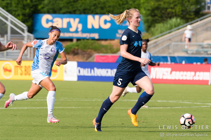 Samantha Mewis (5) and Kristen Edmonds (12) during a match between the NC Courage and the Orlando Pride in Cary, NC in Week 3 of the 2017 NWSL season. Photo by Lewis Gettier.