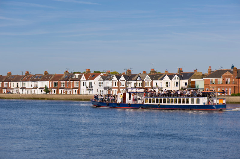 Pleasure boat passing Barnes, SW13, London, United Kingdom