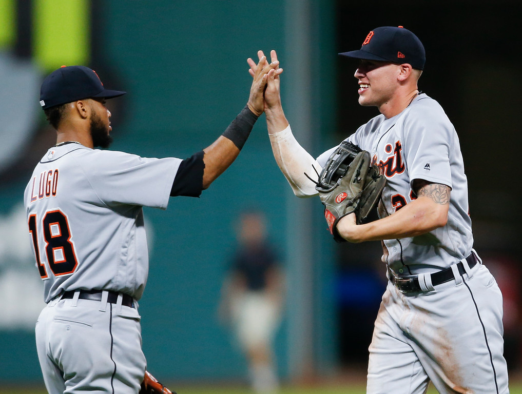 . Detroit Tigers\' JaCoby Jones and Dawel Lugo (18) celebrate a victory over the Cleveland Indians in a baseball game, Friday, Sept. 14, 2018, in Cleveland. (AP Photo/Ron Schwane)
