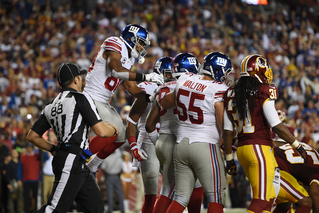 . LANDOVER, MD - SEPTEMBER 25: The New York Giants celebrate their 1st quarter touchdown by tight end Larry Donnell #84 of the New York Giants against the Washington Redskins at FedExField on September 25, 2014 in Landover, Maryland. (Photo by Patrick Smith/Getty Images)