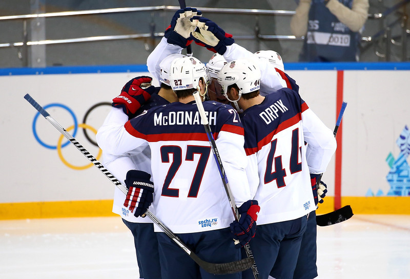 . Paul Stastny #26 of United States scores a celebrates with his teammates after a goal against Jaroslav Halak #41 of Slovakia during the Men\'s Ice Hockey Preliminary Round Group A game on day six of the Sochi 2014 Winter Olympics at Shayba Arena on February 13, 2014 in Sochi, Russia.  (Photo by Streeter Lecka/Getty Images)