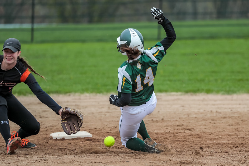 Oxford Hills Ashley Child slides safely into second base as Skowhegan shortstop Jaycie Christopher tries to get a glove on the ball.
