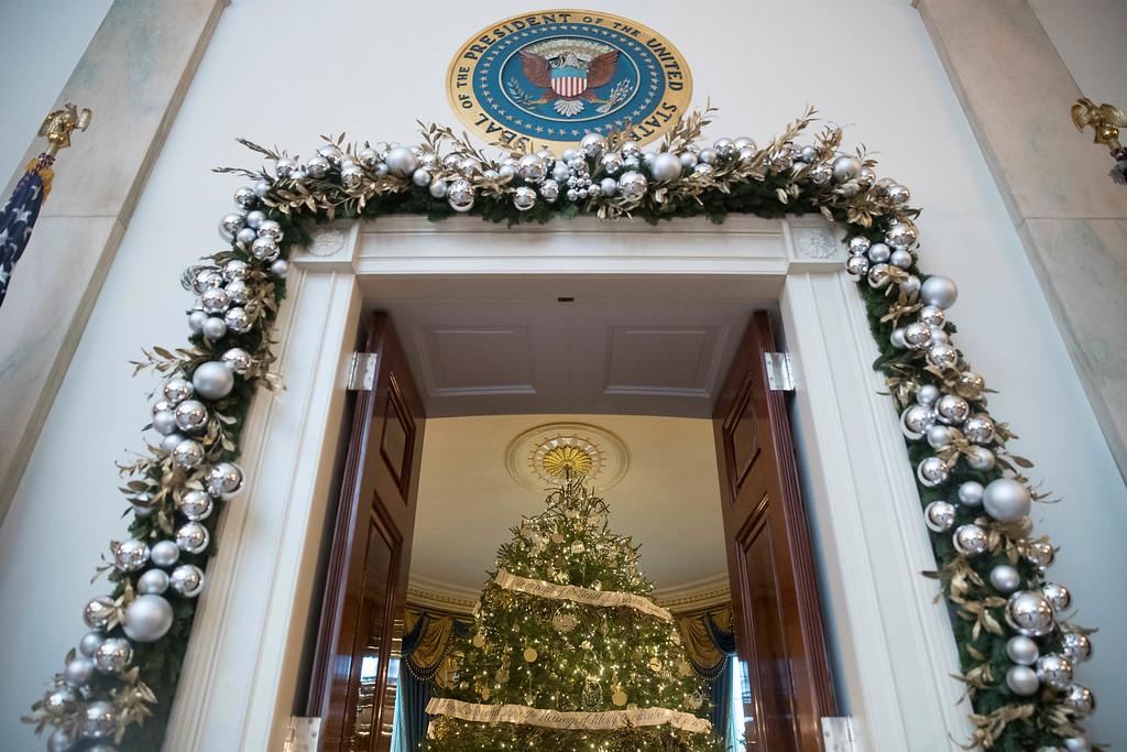 . This year\'s White House Christmas Tree is seen inside the Blue Room from the Cross Hall of the White House during a preview of the 2015 holiday decor at the White House, Tuesday, Nov. 29, 2016, in Washington. (AP Photo/Andrew Harnik)