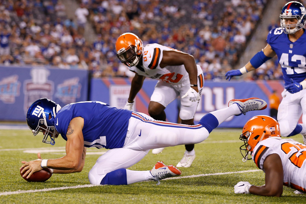. New York Giants\' Zak DeOssie (51) recovers a fumble as Cleveland Browns\' Orson Charles (82) closes in during the second half of a preseason NFL football game Thursday, Aug. 9, 2018, in East Rutherford, N.J. (AP Photo/Adam Hunger)