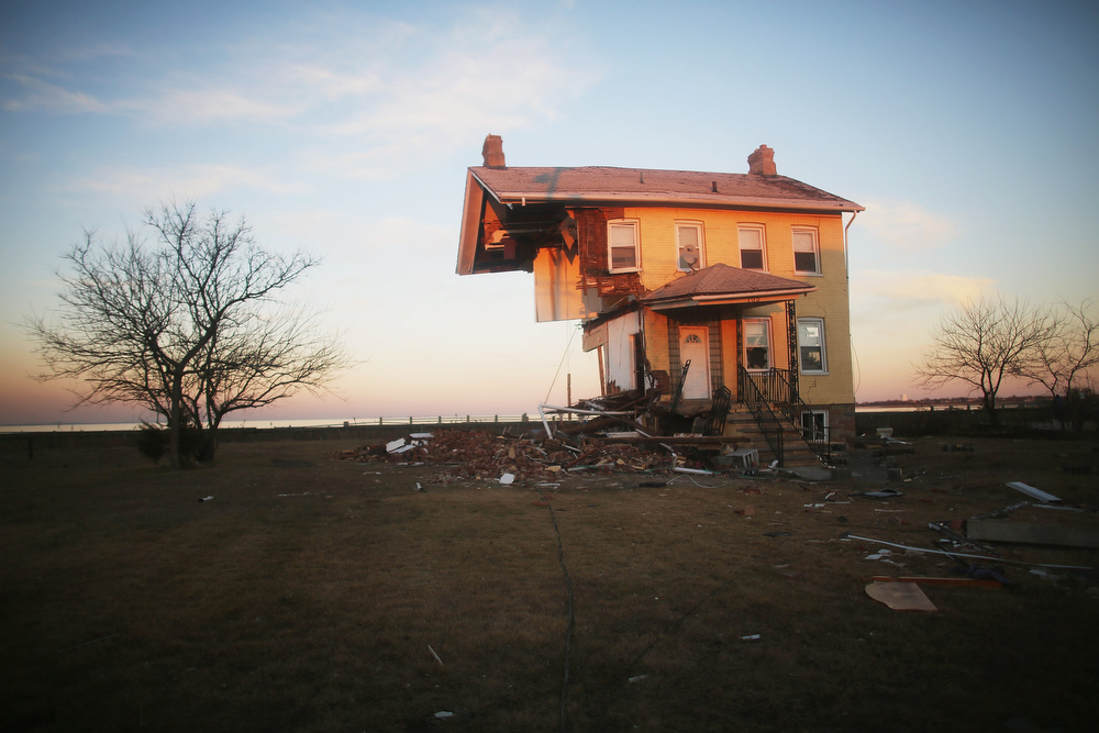 Description of . The iconic Princess Cottage, built in 1855, remains standing after being ravaged by flooding on November 21, 2012 in Union Beach, New Jersey. Little more than half of the home remains and more than 200 homes were destroyed by Superstorm Sandy in the town.  (Photo by Mario Tama/Getty Images)