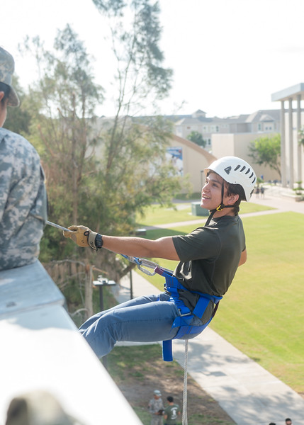 Student Diego Lopez speaks to a ROTC cadet as he begins his rappel down the Center for Sciences building.