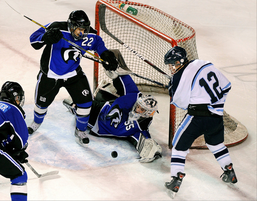 . DENVER, CO. - FEBRUARY 28: Cougars goalie Brandan Alcorn (55) reached for a bouncing puck in front of his net in the second period. Ralston Valley High School took on Resurrection Christian Thursday night, February 28, 2013 in a semifinal match in the Colorado State Ice Hockey Championships at Magness Arena in Denver. (Photo By Karl Gehring/The Denver Post)