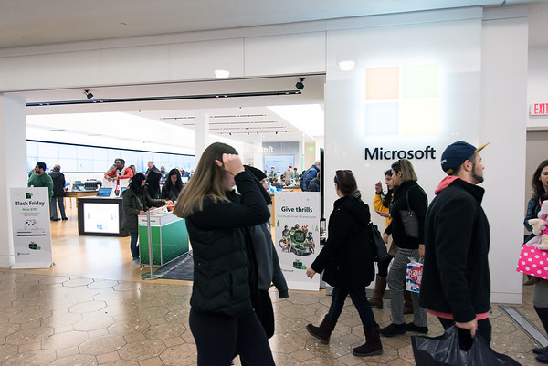 11/23/18 Wesley Bunnell | Staff Shoppers walk past the Microsoft Store on Black Friday in the Westfarms Mall.