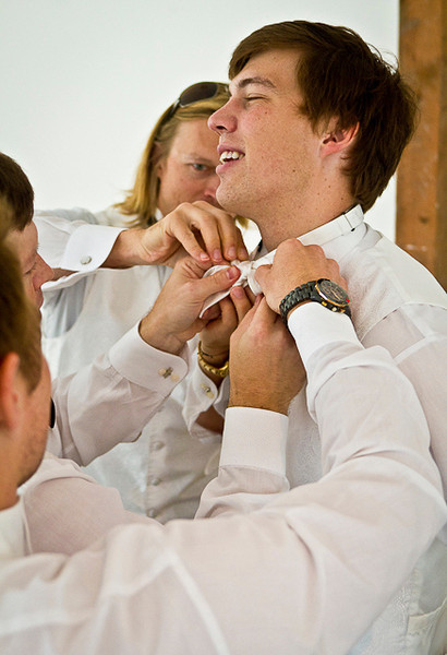 David groomsmen adjust tie.jpg