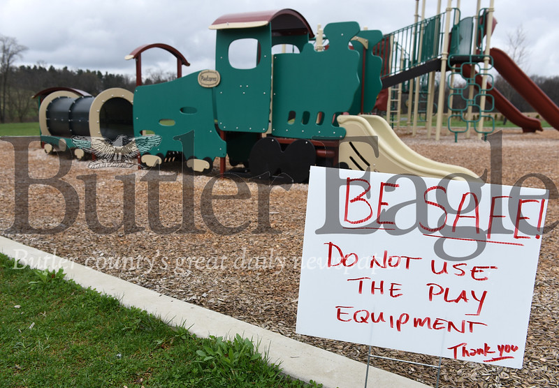 Harold Aughton/Butler Eagle: A sign warns visitors not to use the playground at Harcrest Park in Penn Township, Tuesday, March 31, 2020.