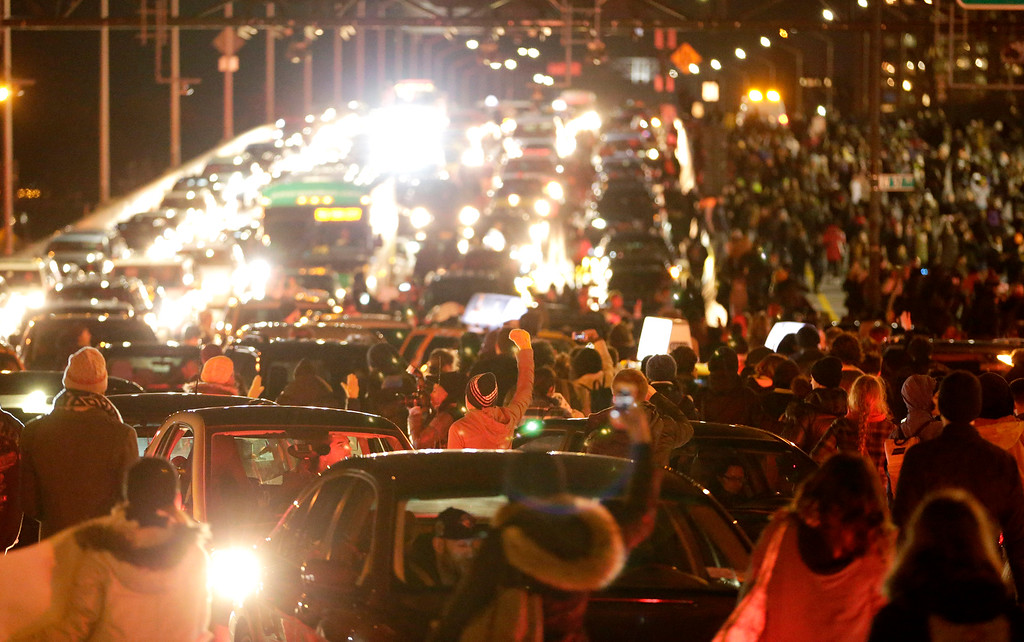 . Vehicles are gridlocked on the West Side Highway by a crowd of protesters after it was announced that the New York City police officer involved in the death of Eric Garner was not indicted, Wednesday, Dec. 3, 2014, in New York. A grand jury cleared the New York City police officer Wednesday in the videotaped chokehold death of Garner, an unarmed black man, who had been stopped on suspicion of selling loose, untaxed cigarettes, a lawyer for the victim\'s family said. (AP Photo/Julio Cortez)