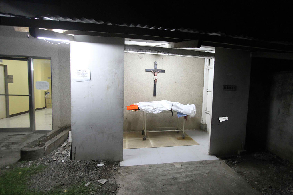 . A  body lies in a morgue at the hospital at a hospital in Cebu after a ferry collided with a cargo ship in Cebu, central Philippines on August 17, 2013. At least 17 people died while nearly 600 others were rescued after a ferry collided with a cargo ship in the Philippines on Friday, authorities said. The Thomas Aquinas ferry, which was believed to be carrying about 700 passengers, sank quickly after colliding with a freighter near the port of Cebu, the country\'s second biggest city, coastguard spokesman Commander Armando Balilo said. CHESTER BALDICANTOS/AFP/Getty Images