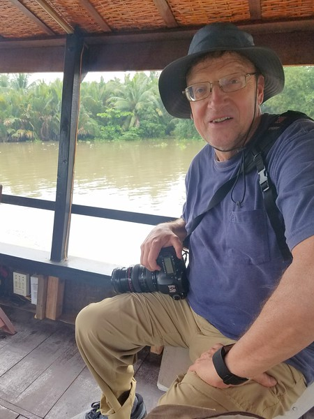 Riding a boat in the Mekong Delta region