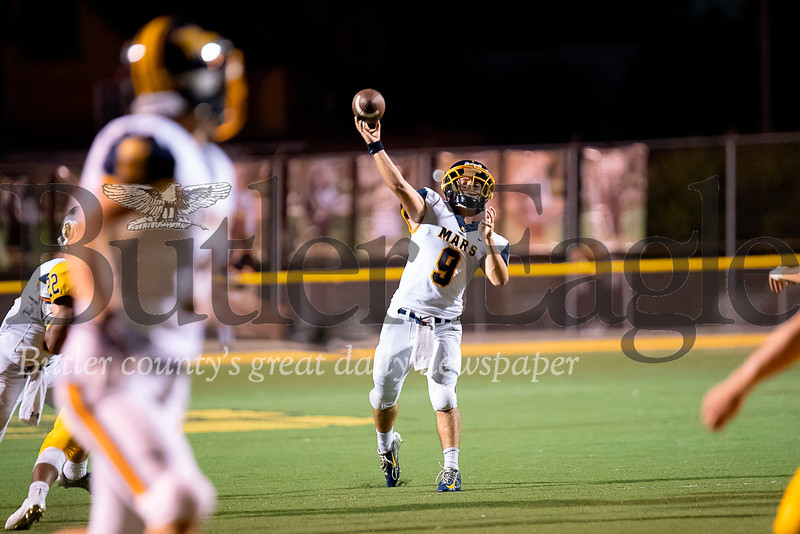 Mars quarterback Tyler Kowalkowski (9) spots wide receiver Andrew Recchia downfield and throws for a 20-yard touchdown pass with 8:22 remaining in the third quarter against Greensburg Salem on Friday, Sep. 7, 2018 at Offutt Field in Greensburg. Mars defeated Greensburg Salem 35-7.  (Ken Reabe Jr | Western PA Sports Media)