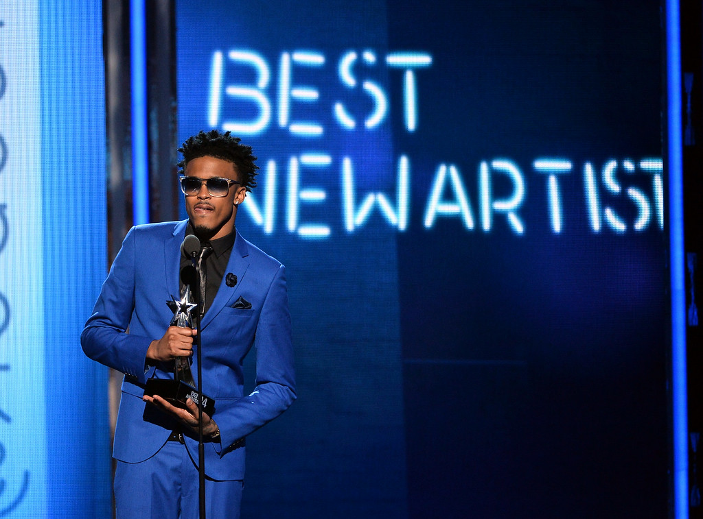 . Singer August Alsina accepts Best New Artist onstage during the BET AWARDS \'14 at Nokia Theatre L.A. LIVE on June 29, 2014 in Los Angeles, California.  (Photo by Kevin Winter/Getty Images for BET)