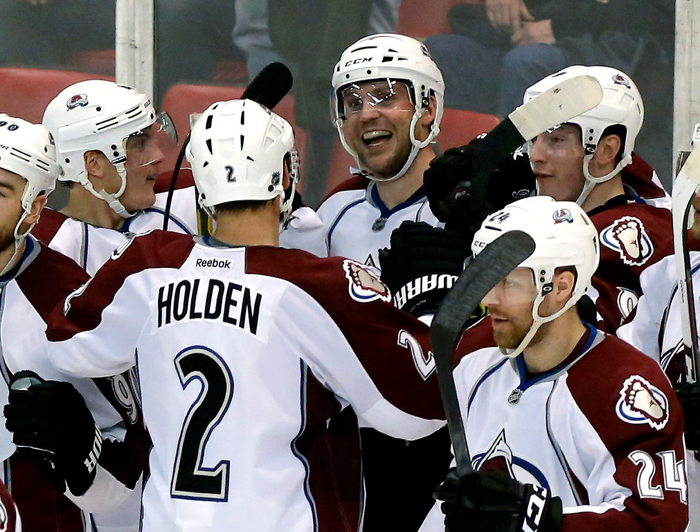 . Colorado Avalanche\'s Andre Benoit smiles with his teammates after scoring the winning goal against the Detroit Red Wings during overtime of an NHL hockey game Thursday, March 6, 2014, in Detroit. The Avalanche defeated the Red Wings 3-2. (AP Photo/Duane Burleson)