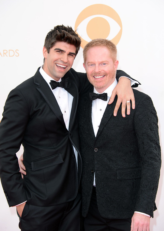 . Actor Jesse Tyler Ferguson (R) and attorney Justin Mikita arrive at the 65th Annual Primetime Emmy Awards held at Nokia Theatre L.A. Live on September 22, 2013 in Los Angeles, California.  (Photo by Jason Merritt/Getty Images)