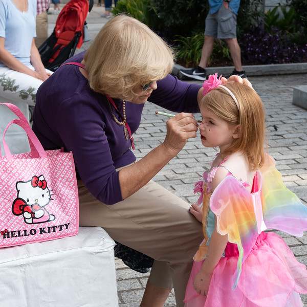 Last minute cosmetics getting ready for the Annual Decatur Book Festival Children's Parade