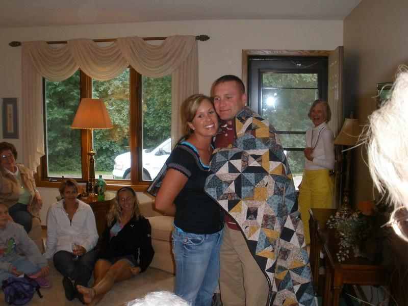 Jodee and Matt enjoying their quilt from Aunt Karen