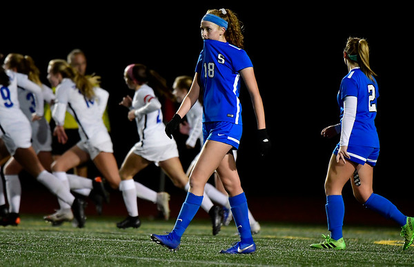 11/23/2019 Mike Orazzi | Staff Southington High School's Abigail Sowa (18) and Jordan Beaudoin (2) as Glastonbury celebrates the only goal in a 1-0 win during the Class LL Girls State Soccer Tournament at Veterans Stadium in New Britain Saturday evening.