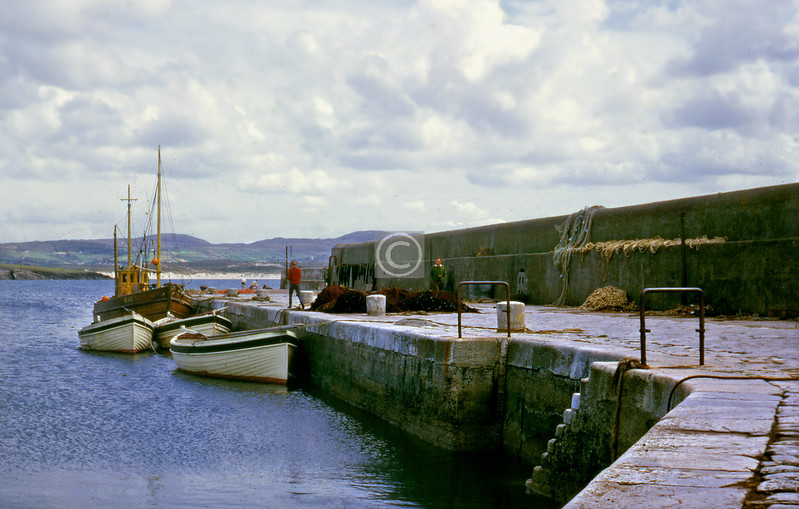 I must have had my Kodak Bantam Colorsnap with me as well, for I've found the slides from an 828 roll of Kodachrome taken on the same trip.  This is Downings harbour, and the fishing boat is the Ros na Cille again.