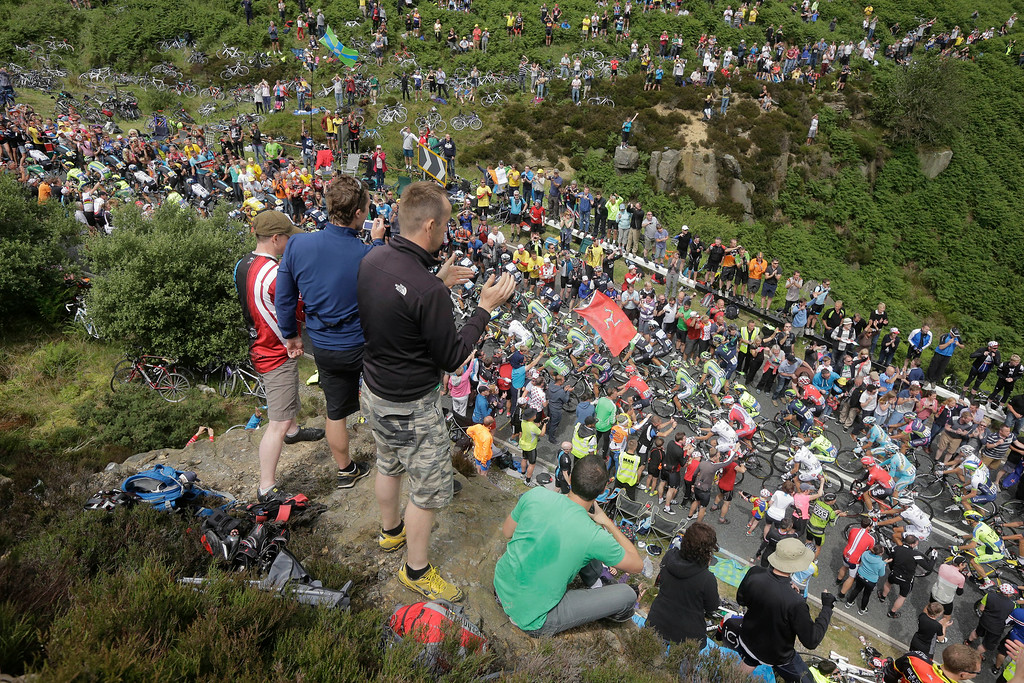 . Spectators line the road as the pack climbs Blubberhouses pass during the second stage of the Tour de France cycling race over 201 kilometers (124.9 miles) with start in York and finish in Sheffield, England, Sunday, July 6, 2014. (AP Photo/Laurent Cipriani)