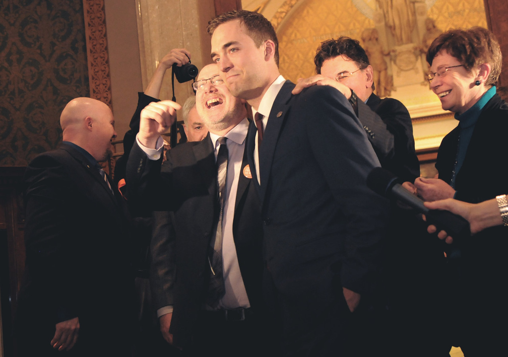 . Rep. Joe Radinovich, DFL-Crosby, center, is cheered upon leaving the House chambers after the floor vote. Radinovich voted with the majority but said it was a hard vote for him because his district voted for a gay marriage ban. (Pioneer Press: Jean Pieri)
