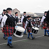 Bass Drummer Robert McDowell and Bessbrook Crimson Arrow Pipe Band drum corp pictured during the march past at the North West Pipe Band & Drum Majors Championships at Portrush on Saturday 22nd August.