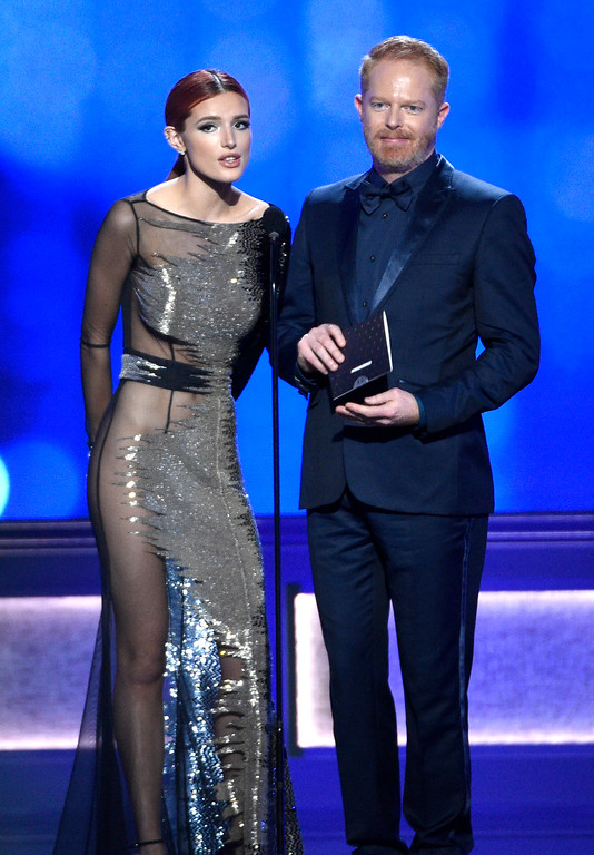 . Bella Thorne, left, and Jesse Tyler Ferguson present the award for best young actor/actress at the 22nd annual Critics\' Choice Awards at the Barker Hangar on Sunday, Dec. 11, 2016, in Santa Monica, Calif. (Photo by Chris Pizzello/Invision/AP)