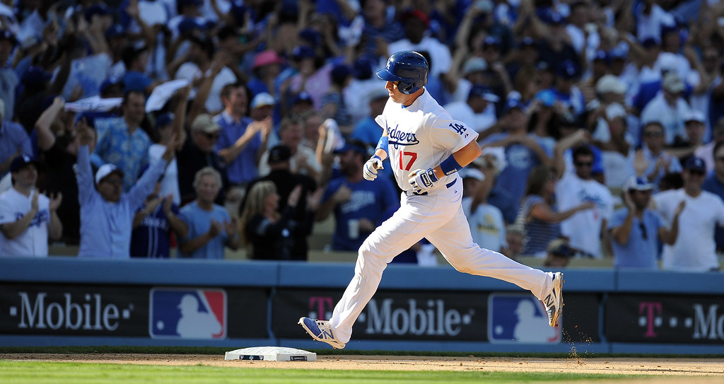 . The Dodgers\' A.J. Ellis rounds the bases after a solo homer in the 7th against the Cardinals during game 5 of the NLCS at Dodger Stadium Wednesday, October 16, 2013. The Dodgers beat the Cardinals 6-4. (Photo by Hans Gutknecht/Los Angeles Daily News)