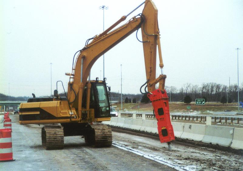 NPK E208 hydraulic hammer on Cat excavator - road construction at 83 & I-71 in Strongsville 12-15-00 (13).jpg