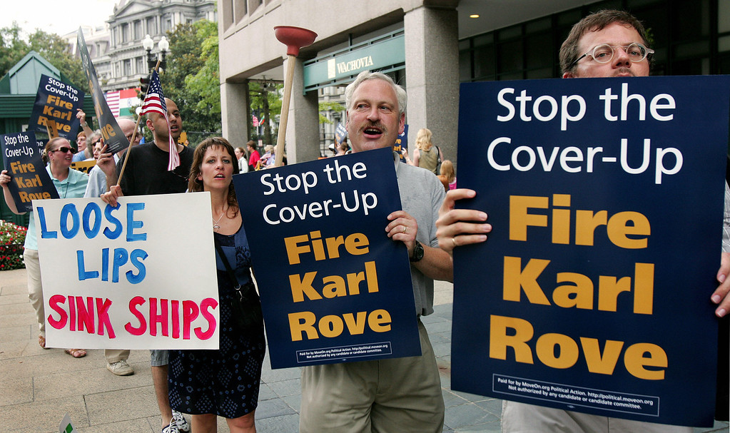 . Washington, UNITED STATES:  Protesters from MoveOn.org march in front of a building on Washington\'s Pennsylvania Avenue near the White House 19 July 2005, where White House Deputy Chief of Staff Karl Rove was attending a fundraising event, calling on President Bush to fire his top political advisor for allegedly disclosing the identiy of CIA agent Valerie Plame.   (PAUL J. RICHARDS/AFP/Getty Images)