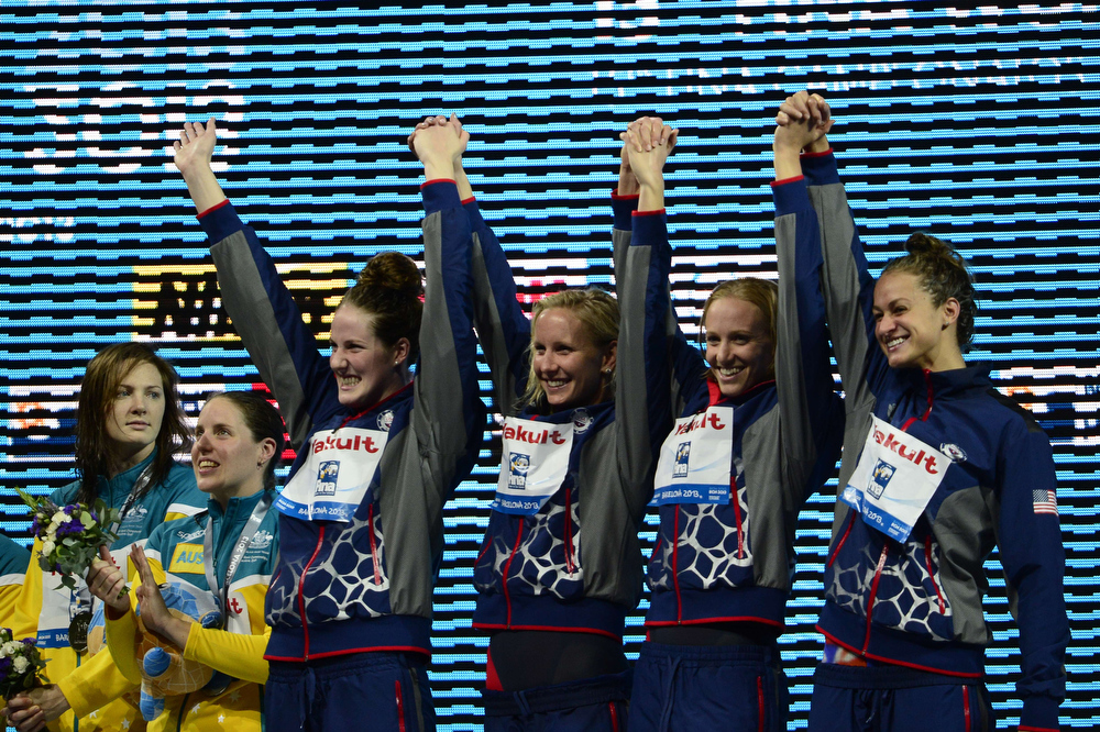 . (From L) Gold medalists US swimmers Missy Franklin, Jessica Hardy, Dana Vollmer and Megan Romano celebrate on the podium during the award ceremony of the women\'s 4x100-metre medley relay swimming event in the FINA World Championships at Palau Sant Jordi in Barcelona on August 4, 2013.  JAVIER SORIANO/AFP/Getty Images