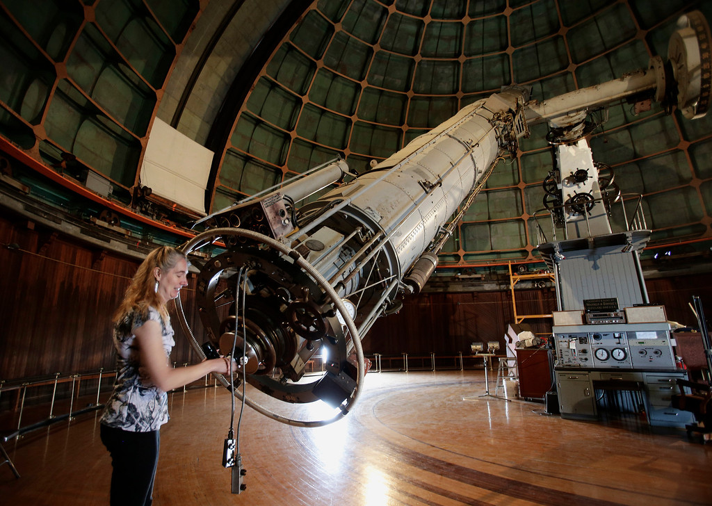 ". Astronomer Elinor Gates installs a viewfinder at the rear of the 36"" Refractor telescope at Lick Observatory east of San Jose, Calif. on May 8, 2013. The observatory will be celebrating its 125th anniversary.  (Gary Reyes/ Bay Area News Group)"