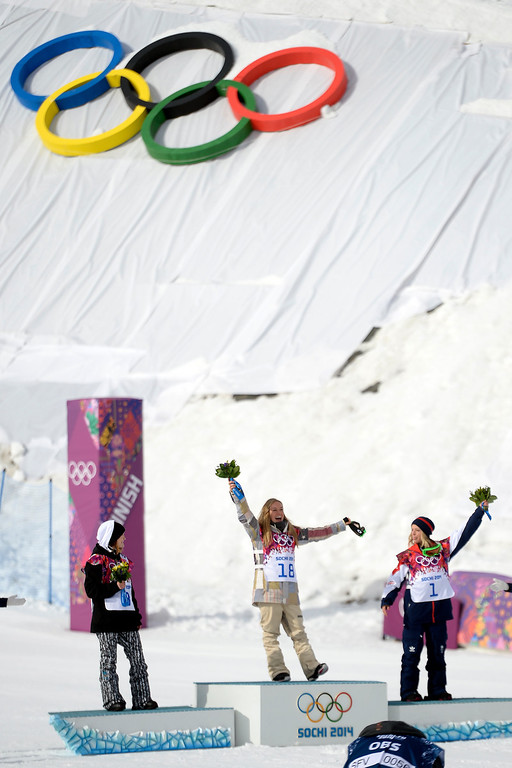 . Gold medalist Jamie Anderson, of the U.S.A., celebrates with silver medalist Enni Rukajarvi, of Finland (left) and bronze medalist Jenny Jones, of Great Britain, during the women\'s snowboard slopestyle final. Sochi 2014 Winter Olympics at the Rosa Khutor Etreme Park on Sunday, February 9, 2014. (Photo by AAron Ontiveroz/The Denver Post)