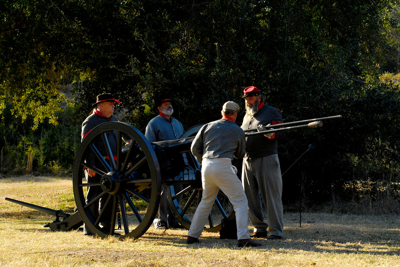 A reenactor with the 13th Battalion, North Carolina Light Infantry, D-Company sponges the piece, which involves ramming a wet spone into the canon to put out sparks and clean it, at the 146th Anniversary of the Fall of Ft. Anderson in Brunswick Town, North Carolina on Sunday, February 20, 2011. Photo Copyright 2011 Jason Barnette