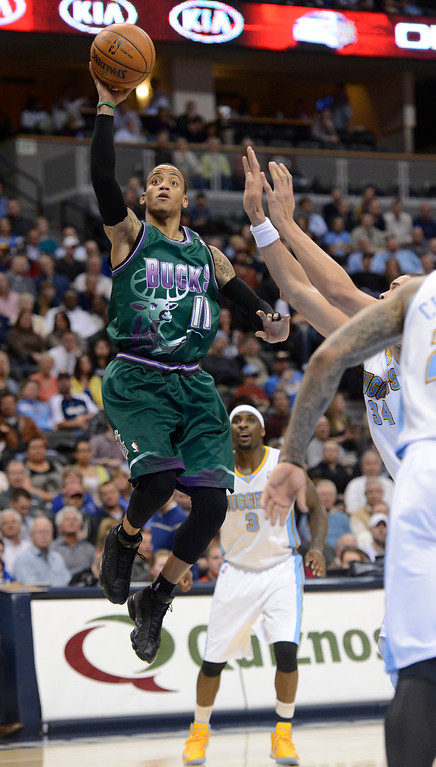. DENVER, CO. - FEBRUARY 05: Monta Ellis (11) of the Milwaukee Bucks gets an easy layup on JaVale McGee (34) of the Denver Nuggets during the third quarter February 05, 2013 at Pepsi Center. The Denver Nuggets defeated the Milwaukee Bucks 112-104 in NBA action. (Photo By John Leyba/The Denver Post)